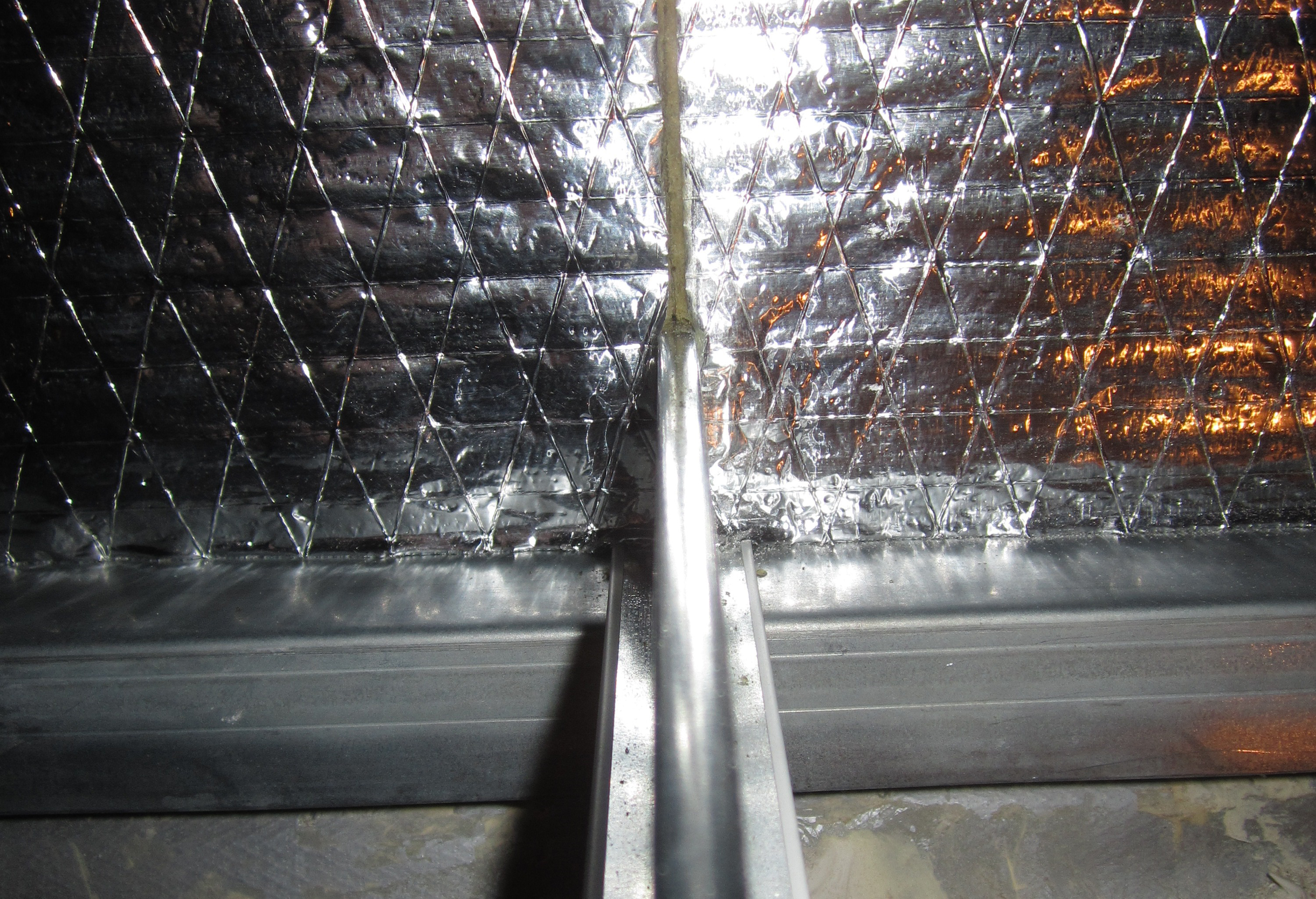 Using Acoustic Plenum Barriers above Interior Partitions to