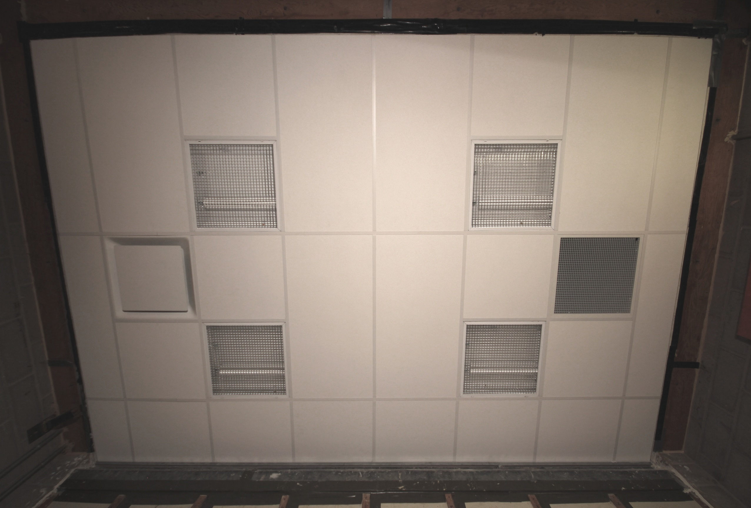 Using Acoustic Plenum Barriers above Interior Partitions to Comply